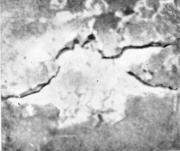 Разорванный пузырь, сильно загрязненный окислами алюминия