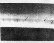 Темные полосы на обработанной поверхности вала