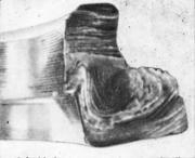 Грубое неметаллическое включение на поверхности обработанной поковки