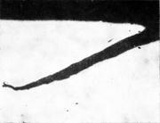 Поперечная трещина на продольном шлифе