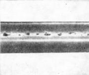 Поры и язвины на поверхности прямошовной трубы