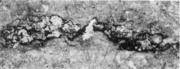 Неметаллические включения (места скопления шлака) на поверхности непрерывнолито