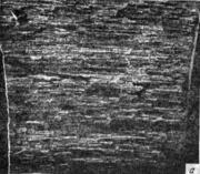 . Волокнисто-полосчатый излом. Катаная сталь. Поверхность разрушения параллельна
