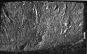 Плотный сухой волокнистый излом. Литая сталь. На поверхности излома видны следы
